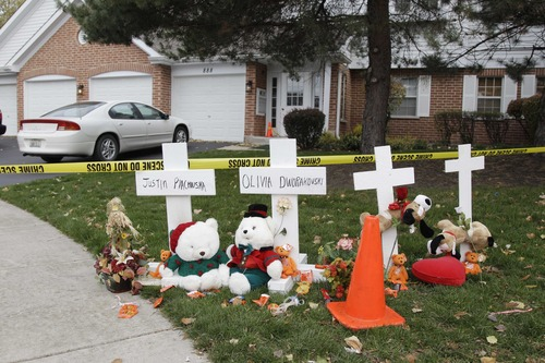 A makeshift memorial is seen outside a home in Naperville, Ill., Thursday, Nov. 1, 2012, where two children were found stabbed to death on Tuesday, Oct. 30.  Elzbieta Plackowska  was accused Thursday of stabbing her 7-year-old son 100 times and a 5-year-old girl she was babysitting about 50 times. (AP Photo/M. Spencer Green)