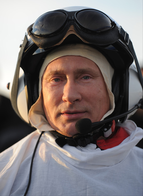 "FILE - In this Wednesday Sept. 5, 2012 file photo, Russian President Vladimir Putin prepares for a flight in a motorized hang glider, on the Yamal Peninsula, in Russia. On Thursday, Nov. 1, 2012, Interfax reported that Putin's spokesman Dmitry Peskov said the president had pulled a muscle. ""It happened before Vladivostok. He was suffering from muscle pain then"", Peskov said. Peskov told state news agency RIA Novosti this was an old injury and denied it was caused by his flight with cranes. (AP Photo/RIA-Novosti, Alexei Druzhinin, Presidential Press Service, File)"