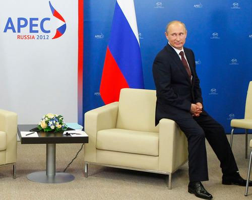 "FILE - In this Friday, Sept. 7, 2012 file pool photo, Russian President Vladimir Putin waits for his meeting with Chinese President Hu Jintao during the Asia-Pacific Economic Cooperation (APEC) summit in Vladivostok, Russia, Friday, Sept. 7, 2012. On Thursday, Nov. 1, 2012, Interfax reported that Putin's spokesman Dmitry Peskov said the president had pulled a muscle. ""It happened before Vladivostok. He was suffering from muscle pain then"", Peskov said. Peskov told state news agency RIA Novosti this was an old injury and denied it was caused by his flight with cranes. (AP Photo/RIA-Novosti, Mikhail Klimentyev, Presidential Press Service, File)"