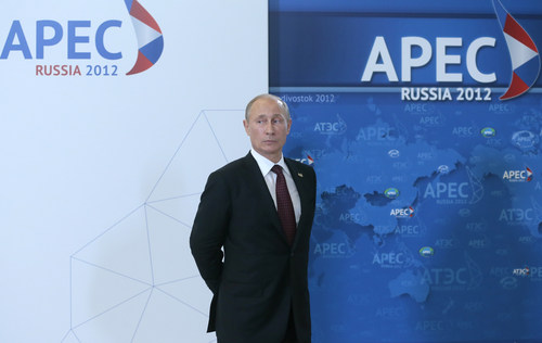 "FILE - In this Saturday, Sept. 8, 2012 file photo, Russian President Vladimir Putin waits for other leaders during the arrival ceremony the Asia-Pacific Economic Cooperation (APEC) Summit in Vladivostok, Russia. On Thursday, Nov. 1, 2012, Interfax reported that Putin's spokesman Dmitry Peskov said the president had pulled a muscle. ""It happened before Vladivostok. He was suffering from muscle pain then"", Peskov said. Peskov told state news agency RIA Novosti this was an old injury and denied it was caused by his flight with cranes.  (AP Photo/Mikhail Metzel, Pool, File)"