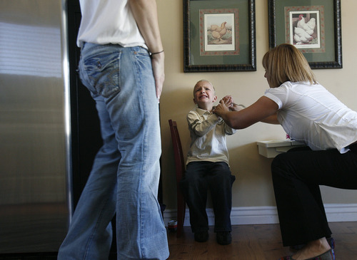 Scott Sommerdorf     The Salt Lake Tribune               Therapist Breanne Berg, right, works with Nicole VanBuskirk's 6-year-old autistic son, Austin. Berg teaches an autism therapy like the one covered in the state-funded pilot, Monday, October 29, 2012.