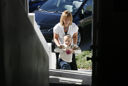 Scott Sommerdorf     The Salt Lake Tribune               Therapist Breanne Berg arrives home with Nicole VanBuskirk's 6-year-old son, Austin, after his day at school. Austin, who is autistic, works with Berg who teaches an autism therapy like the one covered in the state-funded pilot, Monday, October 29, 2012.