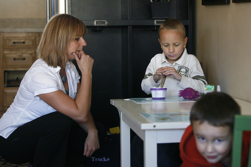 Scott Sommerdorf     The Salt Lake Tribune               Nicole VanBuskirk's 6-year-old son, Austin, center, who is autistic, works with Breanne Berg, left, who teaches an autism therapy like the one covered in the state-funded pilot, Monday, October 29, 2012. Austin's brother, Trevor, is at the lower right.