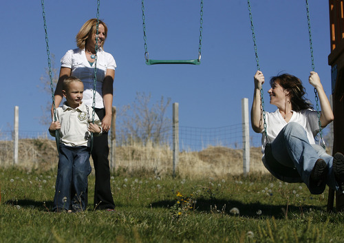 Scott Sommerdorf  |  The Salt Lake Tribune               Nicole VanBuskirk's 6-year-old autistic son, Austin, left, works with Breanne Berg, left, who teaches an autism therapy like the one covered in the state-funded pilot, Monday, October 29, 2012.