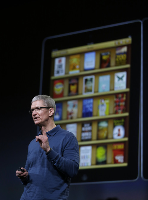 (AP Photo/Marcio Jose Sanchez) Apple, prevoiusly under Steve Jobs and now under successor Tim Cook, above, has favored virtual doodads that mimic the appearance and behavior of real-world things, such as wooden shelves for organizing newspapers and the page-flipping motion of a book,
