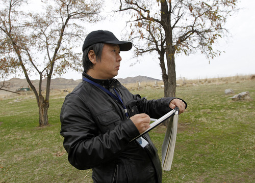 Al Hartmann  |  The Salt Lake Tribune Jian Liu, a nationally famous artist in China does a pen and ink sketch of a scene at the Garr Ranch at the south end of Antelope Island Thursday Novmeber 1.   The group of artists spent the day photographing and sketching scenes at the ranch.    The Division of Utah State Parks on behalf of Antelope Island is signing a sister/marketing relationship with the Jinshanling section of the Great Wall in China.
