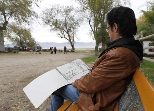 Al Hartmann  |  The Salt Lake Tribune Yang Jiayong, Director of Beijing Office of the China Artists Association does a pen and ink sketch of a scene at the Garr Ranch at the south end of Antelope Island Thursday Novmeber 1.   The group of artists spent the day photographing and sketching scenes at the ranch.    The Division of Utah State Parks on behalf of Antelope Island is signing a sister/marketing relationship with the Jinshanling section of the Great Wall in China.