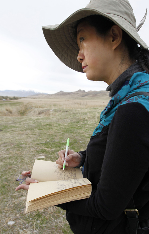Al Hartmann  |  The Salt Lake Tribune Cao Xiang Bin, a member of a Chinese artist group does a pen and ink sketch at the Garr Ranch at the south end of Antelope Island Thursday Novmeber 1.   The group of artists spent the day photographing and sketching.   The Division of Utah State Parks on behalf of Antelope Island is signing a sister/marketing relationship with the Jinshanling section of the Great Wall in China.