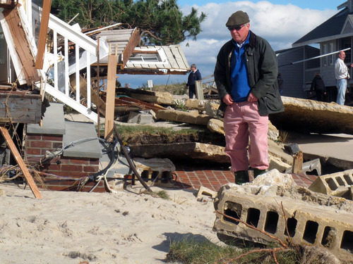 Peter Green looks at the wreckage of his oceanfront home in Bay Head, N.J. on Oct. 31, 2012. He says youths stole golf clubs from the ruins of his home on a stretch of Jersey shore that was devastated by Hurricane Sandy. (AP Photo/Wayne Parry)