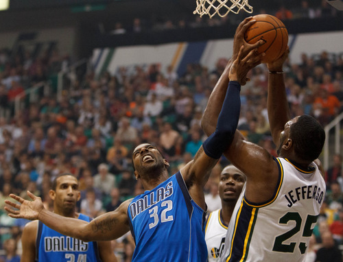 Trent Nelson  |  The Salt Lake Tribune Dallas's O.J. Mayo and Utah center/forward Al Jefferson (25) reach for the rebound during the Jazz season opener Wednesday, Oct. 31, 2012 at EnergySolutions Arena in Salt Lake City.