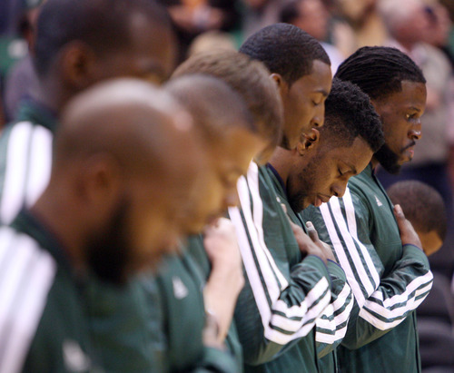 Steve Griffin | The Salt Lake Tribune   Jazz players listen to the National Anthem at the start of the season opener against the Dallas Mavericks at EnergySolutions Arena  in Salt Lake City on Wednesday, Oct. 31, 2012.