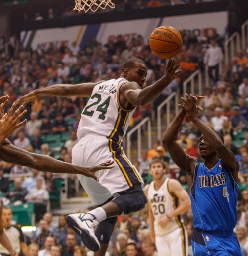 Trent Nelson  |  The Salt Lake Tribune Utah Jazz forward Paul Millsap (24) knocks the ball away from Dallas's Darren Collison during the Jazz season opener Wednesday, Oct. 31, 2012 at EnergySolutions Arena in Salt Lake City.
