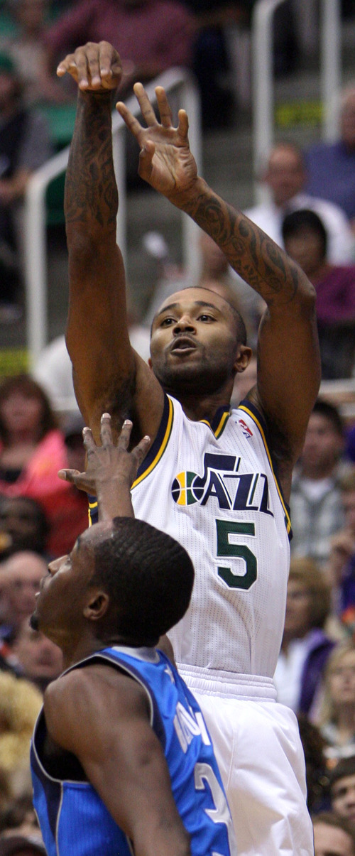 Steve Griffin   The Salt Lake Tribune   Utah's Mo Williams shoots over Dallas guard  during  first-half action in the season opener against the Dallas Mavericks at EnergySolutions Arena  in Salt Lake City on Wednesday, Oct. 31, 2012.