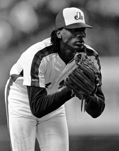 FILE - In this June 6, 1989, file photo, Montreal Expos pitcher Pascual Perez stares towards home plate during baseball action against the St. Louis Cardinals in Montreal. The former major league pitcher, who had a troubled 11-season career that included two suspensions for drug use, was killed at his home in the Dominican Republic in an apparent robbery, police said Thursday, Nov. 1, 2012. (AP Photo/The Canadian Press, Paul Chiasson, File)