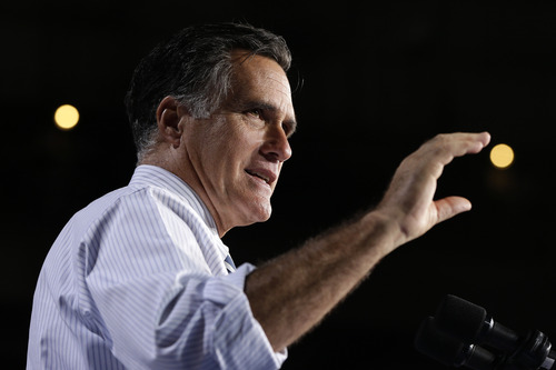 Republican presidential candidate, former Massachusetts Gov. Mitt Romney gestures as he speaks at a campaign stop at the Bank United Center, at The University of Miami, in Coral Gables, Florida, Wednesday, Oct. 31, 2012. At rear are stadium lights. (AP Photo/Charles Dharapak)