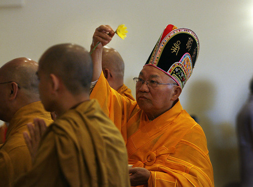Scott Sommerdorf  |  The Salt Lake Tribune Buddhist Monk, Thich Tri Lang, of the Unified Vietnamese Buddhist Congregation in the United States, uses a Chrsanthemum to consecrate the Temple during a ceremony at the Lien Hoa Buddhist Temple which opened Sunday in West Valley City, Sunday, April 17, 2011.