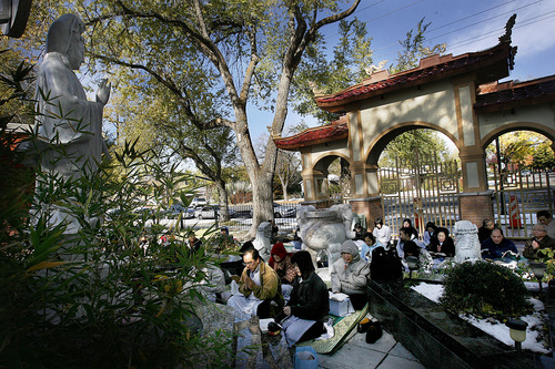Scott Sommerdorf  |  The Salt Lake Tribune              Beside a controversial gate, members of the Pho Quang Pagoda Buddhist temple hold their traditional Sunday, 11am, services in the garden outside the temple, Sunday, November 6, 2011. Inside, Nun Kien Khong who has come to hold the deed under questionable circumstances, conducts services. The complex dispute is headed to a January trial.