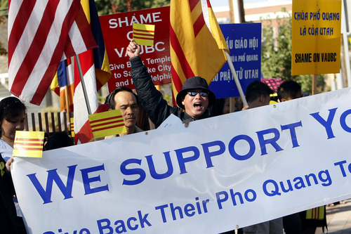 Chris Detrick  |  The Salt Lake Tribune Nam Quoc Nguyen leads other members of the local Buddhist congregation of Pho Quang Temple as they protest outside the Temple Lien Hoa Buddhist on Saturday, Oct. 6, 2012. They hoped to highlight their conflict to the monks, who belong to the California-based Vietnamese-American Unified Buddhist Congress, which is seeking to take control of Pho Quang.
