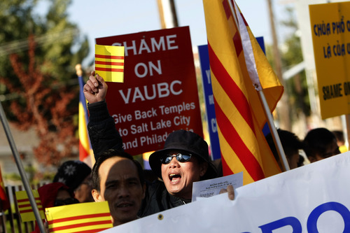 Chris Detrick  |  The Salt Lake Tribune Nam Quoc Nguyen leads other members of the local Buddhist congregation of Pho Quang Temple as they protest outside the Temple Lien Hoa Buddhist Members of the local Buddhist congregation of Pho Quang on Saturday, Oct. 6, 2012. They hoped to highlight their conflict to the monks, who belong to the California-based Vietnamese-American Unified Buddhist Congress, which is seeking to take control of Pho Quang.
