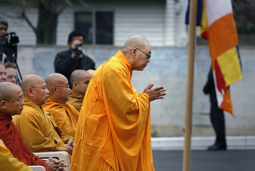 Scott Sommerdorf  |  The Salt Lake Tribune Buddhist Monk, Thich Tri Lang, of the Unified Vietnamese Buddhist Congregation in the United States, bows as he is introduced at the opening of the Lien Hoa Buddhist Temple Sunday, April 17, 2011.
