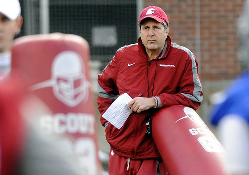 FILE - In this March 22, 2012, file photo, Washington State head coach Mike Leach watches his team during their first spring NCAA college football practice in Pullman, Wash. (AP Photo/Lewiston Tribune, Kyle Mills)