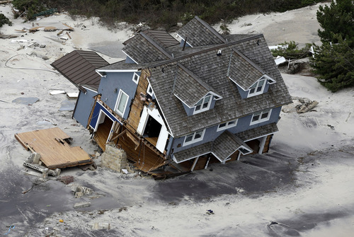 This aerial photo shows a collapsed house along the central Jersey Shore coast on Wednesday, Oct. 31, 2012. New Jersey got the brunt of Sandy, which made landfall in the state and killed six people. More than 2 million customers were without power as of Wednesday afternoon, down from a peak of 2.7 million. (AP Photo/Mike Groll)