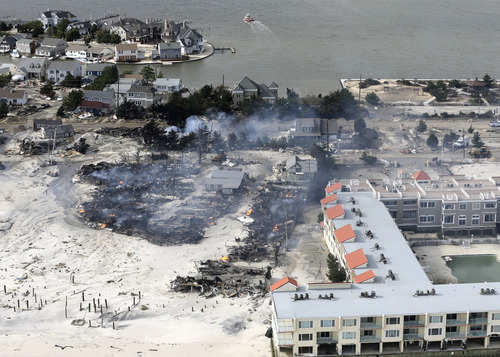 This aerial photo shows a fire in the wake of superstorm Sandy in the central Jersey Shore on Wednesday, Oct. 31, 2012, in New Jersey. (AP Photo/Mike Groll)