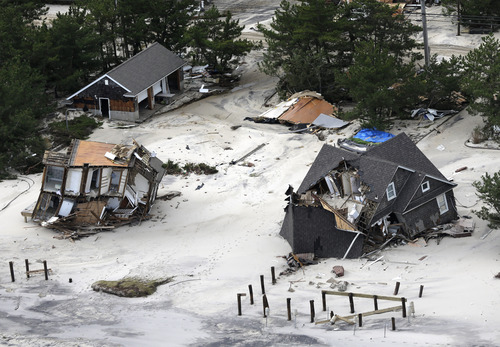 This aerial photo shows damage in the wake of superstorm Sandy in the central Jersey Shore area of New Jersey on Wednesday, Oct. 31, 2012. (AP Photo/Mike Groll)