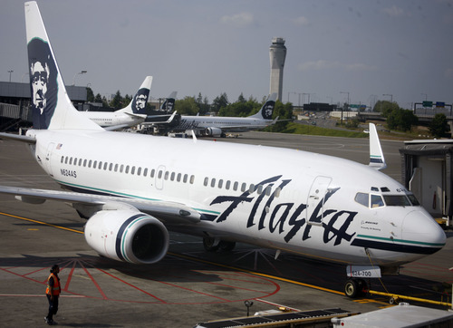 The new Alaska service between Salt Lake City and Seattle appears to replace the nonstop route between Utah's capital and Narita Airport in Tokyo that Delta eliminated last year. (AP Photo/David Zalubowski)