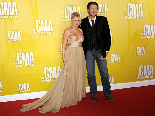 Miranda Lambert, left, and Blake Shelton arrive at the 46th Annual Country Music Awards at the Bridgestone Arena on Thursday, Nov. 1, 2012, in Nashville, Tenn. (Photo by Chris Pizzello/Invision/AP)