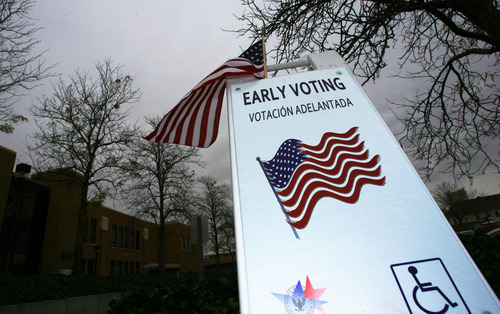 Steve Griffin  |  The Salt Lake Tribune A sign reminds citizens to vote early at the Murray City Hall on Thursday.