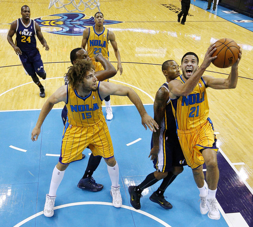 New Orleans Hornets point guard Greivis Vasquez (21) goes to the basket during the first half of an NBA basketball game against the Utah Jazz in New Orleans, Friday, Nov. 2, 2012. (AP Photo/Jonathan Bachman)