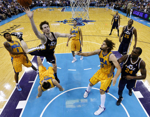 Utah Jazz shooting guard Gordon Hayward (20) shoots the ball over New Orleans Hornets power forward Ryan Anderson (33) during the second half of an NBA basketball game in New Orleans, Friday, Nov. 2, 2012. The Hornets won 88-86. (AP Photo/Jonathan Bachman)