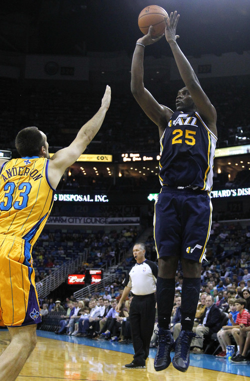 Utah Jazz center Al Jefferson (25) shoots the ball over New Orleans Hornets power forward Ryan Anderson (33) during the first half of an NBA basketball game in New Orleans, Friday, Nov. 2, 2012. The Hornets won 88-86. (AP Photo/Jonathan Bachman)