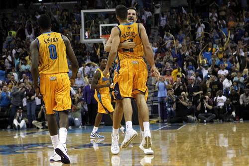 New Orleans Hornets point guard Greivis Vasquez (21) celebrates with power forward Ryan Anderson after scoring the game-winning basket during the second half of an NBA basketball game against the Utah Jazz in New Orleans, Friday, Nov. 2, 2012. The Hornet won 88-86. (AP Photo/Jonathan Bachman)
