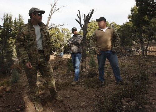 Leah Hogsten  |  The Salt Lake Tribune l-r Rodney Holliday with DEA, Brian Lacy and Brian Bairett with the Iron, Garfield and Beaver County Narcotics Task Force stand in what once was a marijuana grove that once held more than 4,200 plants in Iron County, Thursday, November 1, 2012. Cooperation among federal agents, prosecutors and county sheriffs coupled with a drought have helped reduce the amount of marijuana grown in Utah primarily by the La Familia cartel from Michoacan, Mexico, the primary grower in Utah.