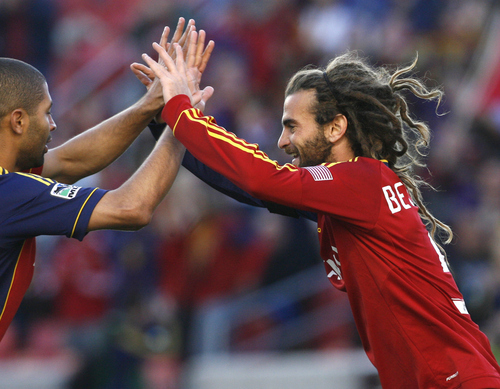 Rick Egan  | The Salt Lake Tribune  Real Salt Lake's Kyle Beckerman celebrates a goal with Fabian Espindola in April. RSL opens the two-game aggregate series Friday night at CenturyLink Field, after three regular-season matches with the Seattle Sounders, during which goals were as scarce as November sunshine in the Pacific Northwest.