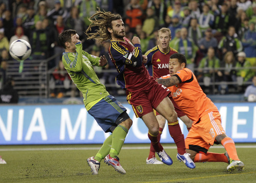 Real Salt Lake goalkeeper Nick Rimando, right, tangles with teammate Kyle Beckerman, second from left, as Seattle Sounders' Christian Tiffert, left, and Real Salt Lake's Nat Borchers, second from right, look on, in the second half of a MLS Western Conference semifinal soccer match, Friday, Nov. 2, 2012, in Seattle. Rimando was injured on the play, but stayed in the match, the first of a two-match aggregate game, which finished with a score of 0-0. (AP Photo/Ted S. Warren)