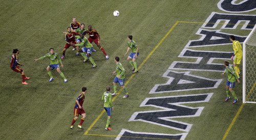 Real Salt Lake and the Seattle Sounders play off of a corner-kick as Sounders goalkeeper Michael Gspurning, upper right, looks on in the first half of a MLS playoff soccer match on Friday, Nov. 2, 2012, in Seattle. (AP Photo/Ted S. Warren)