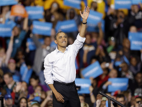 President Barack Obama waves after speaking at a campaign event Saturday, Nov. 3, 2012, in Milwaukee. (AP Photo/Morry Gash)
