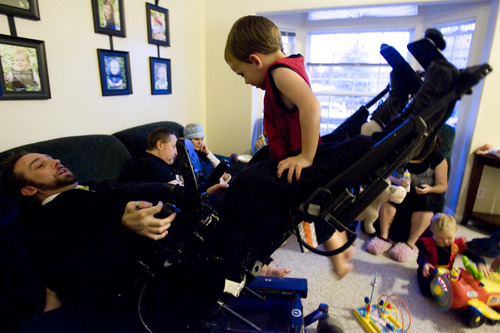 Kim Raff  |  The Salt Lake Tribune Rich McKenzie plays on his wheelchair with his nephew Canyon McKenzie at his home in Plain City, Utah, on October 28, 2012. Rich McKenzie was with his four friends on a trip at the San Rafael Swell in celebration of their high school graduation when he dove into a river with a hidden sandbar just below the surface. He became instantly paralyzed. Fourteen years later, the five have stayed friends, all getting married and starting families except for Rich -- until now. He met Amy Terry last year and they were married last month.