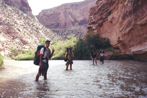 Courtesy image The group of friends enjoy the slot canyons and river in the San Rafael Swell in southcentral Utah on their high school graduation trip in 1998. The trip turned from fun to almost deadly when Rich McKenzie dove onto a hidden sandbar into the river, dislocating both his shoulders and shattering the C-5 vertebrae in his neck. Hours away from help and unable to move Rich, he and his four friends relied on miracles to get them out of the desert alive.