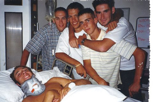 Courtesy image Friends gather July 15, 1998, at LDS Hospital in Salt Lake City the day after Rich McKenzie had neck fusion surgery to attempt to lessen the damage he had caused to his neck when he dove onto a hidden sandbar while the group of friends visited the San Rafael Swell in southcentral Utah. Gathered at Rich's bedside are Pete Norseth, left, Steve Kippen, Dave McKenzie and Chris Hanson.