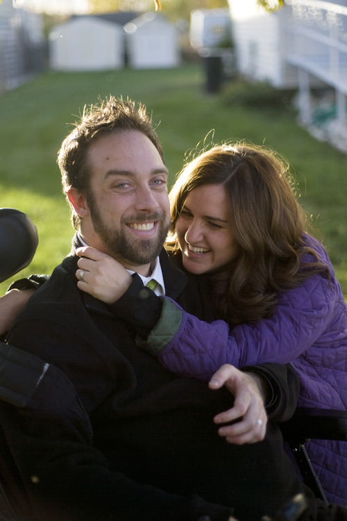 Kim Raff  |  The Salt Lake Tribune Newlyweds Rich and Amy McKenzie outside their home in Plain City, Utah, on October 28, 2012. Rich McKenzie was with his four friends on a trip at the San Rafael Swell in celebration of their high school graduation when he dove into a river with a hidden sandbar just below the surface. He became instantly paralyzed. Fourteen years later, the five have stayed friends, all getting married and starting families except for Rich -- until now. He met Amy Terry last year and they were married last month.