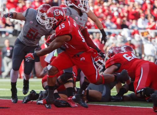 Trent Nelson  |  The Salt Lake Tribune Utah running back John White (15) scores a touchdown as Utah hosts Washington State, college football at Rice-Eccles Stadium Saturday November 3, 2012 in Salt Lake City.