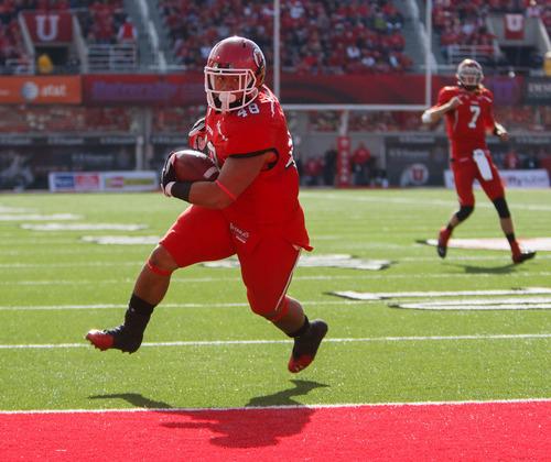 Trent Nelson  |  The Salt Lake Tribune Utah fullback Max Moala (48) scores a touchdown as Utah hosts Washington State, college football at Rice-Eccles Stadium Saturday November 3, 2012 in Salt Lake City.
