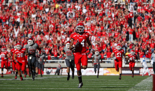 Trent Nelson  |  The Salt Lake Tribune Utah wide receiver Reggie Dunn (14) sets an NCAA record with his fourth career 100-yard touchdown return as Utah hosts Washington State, college football at Rice-Eccles Stadium Saturday November 3, 2012 in Salt Lake City.