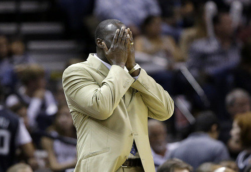 Utah Jazz coach Tyrone Corbin covers his face as he reacts to a play during the fourth quarter of an NBA basketball game against the San Antonio Spurs, Saturday, Nov. 3, 2012, in San Antonio. (AP Photo/Eric Gay)
