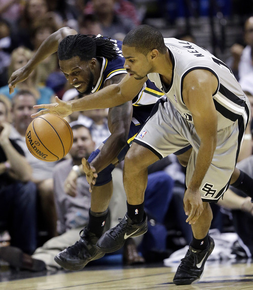 Utah Jazz' DeMarre Carroll, left, and San Antonio Spurs' Gary Neal, right, chase the loose ball during the second quarter of an NBA basketball game, Saturday, Nov. 3, 2012, in San Antonio. San Antonio won 86-84. (AP Photo/Eric Gay)