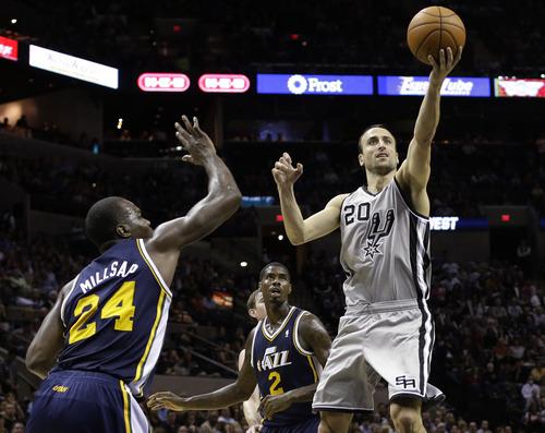 San Antonio Spurs' Manu Ginobili (20), of Argentina, shoots as Utah Jazz defenders Paul Millsap (24) and Marvin Williams (2) look on during the third quarter of an NBA basketball game, Saturday, Nov. 3, 2012, in San Antonio. (AP Photo/Eric Gay)